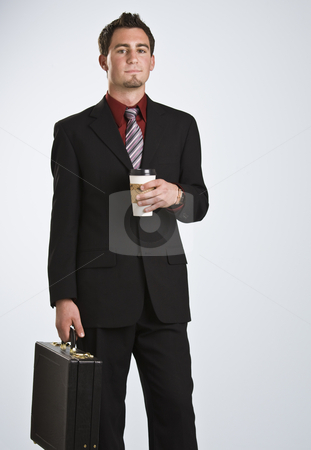 Attractive man with coffee and briefcase stock photo, Attractive man with coffee and briefcase facing the camera wearing a business suit and tie. vertical by Jonathan Ross