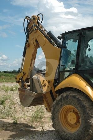 Yellow backhoe stock photo, Yellow construction  excavator by Gary Nicolson