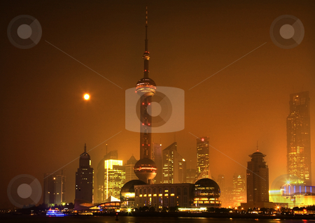 Shanghai Pudong Skyline at Night TV Tower with Moon Orange Haze stock photo, Shanghai Pudong China Skyline at Night with TV Tower with Moon and ReflectionsOrange HazeResubmit--In response to comments from reviewer have further processed image to reduce noise and sharpen focus.Trademarks removed.Trademarks removed. by William Perry