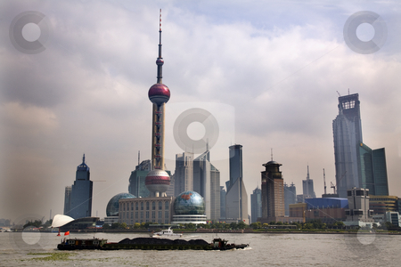 Shanghai Pudong Skyline TV Tower Daytime with Boat stock photo, Shanghai Pudong Chna Skyline Daytime TV Tower with Coal Barge in front With Trademarks by William Perry
