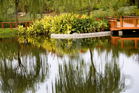 Weilaiyu Shanghai Suburbs Garden Red Flowers Willows Water Refle stock photo, Weilaiyu Shanghai Suburbs Garden Water Reflections Red Flowers Willows Wooden  Pier Summer by William Perry