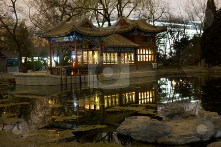 Stone Boat Temple of Sun Pond Reflection Beijing China stock photo, Stone Boat Temple of Sun, Beijing China, Pond, Reflection, Evening, Night Shot by William Perry