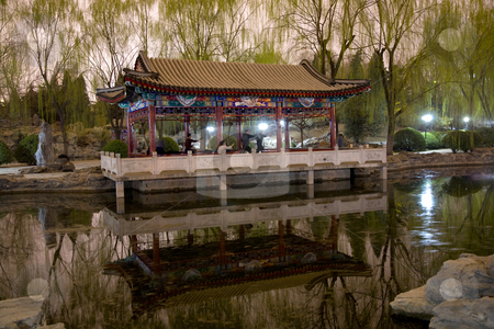 Wushu in Park, Practicing Tai Chi, Temple of Sun pavilion stock photo, Wushu in Park, Practicing Tai Chi, Temple of Sun Pavilion, Pond, Reflection, Willows, Beijing, China by William Perry
