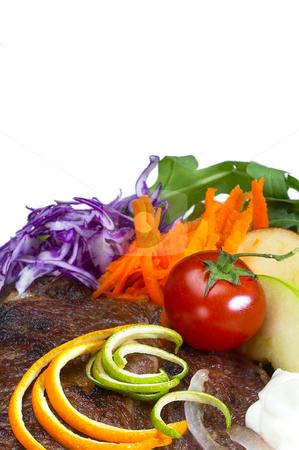 Beef ribeye steak stock photo, Fresh juicy beef ribeye steak grilled with orange and lemon peel on top and vegetables beside by Francesco Perre