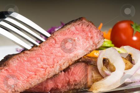 Beef ribeye steak stock photo, Fresh juicy beef ribeye steak sliced ,with lemon and orange peel on top  and vegetable beside by Francesco Perre
