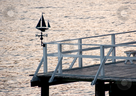 A sailboat weather vane on a boat dock in the bay of san francisco stock photo,  by Shi Liu