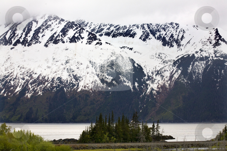 Snow Mountain Close Up Seward Highway Anchorage Alaska stock photo, Snow Mountains Close Up Trees, Island, Ocean and Coastline, Seward Highway, Anchorage, Alaska by William Perry