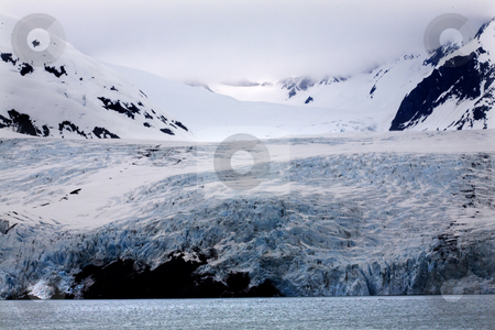 Blue Icy Portage Glacier and Mountain Alaska stock photo, Blue Icy Portage Glacier Mountain Anchorage AlaskaThe blue is from the glacier. by William Perry
