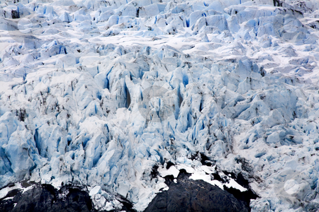 Blue Icy Portage Glacier with Rock and Crevaces Alaska stock photo, Blue Icy Portage Glacier with Black Rock Anchorage, Alaska by William Perry