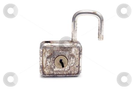 Old padlock stock photo, Old padlock isolated on white background by Ingvar Bjork
