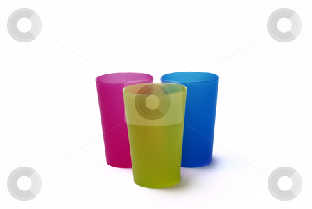 Toothbrush holders stock photo, Color toothbrush holders on the white background by Roman Kalashnikov