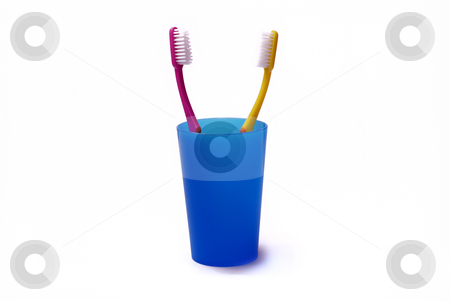 Toothbrush in a color holder stock photo, Toothbrush in a color holder on a white background by Roman Kalashnikov