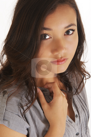 Beautiful young model in the studio stock photo, A beautiful young Indonesian model in the studio, isolated on white. by Nicolaas Traut