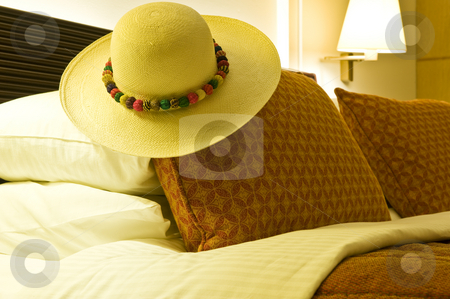 Luxurious hotel room stock photo, Inside of a luxurious hotel room with a Panama hat on the bed. by Nicolaas Traut