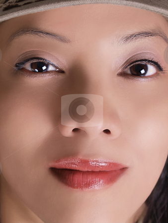 Extreme closeup of hispanic woman portrait hat stock photo, Tight closeup of latina woman in ball cap by Jeff Cleveland