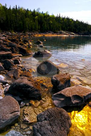 Rocks at shore of Georgian Bay stock photo, Rocks in clear golden water of Georgian Bay at Bruce peninsula Ontario Canada by Elena Elisseeva