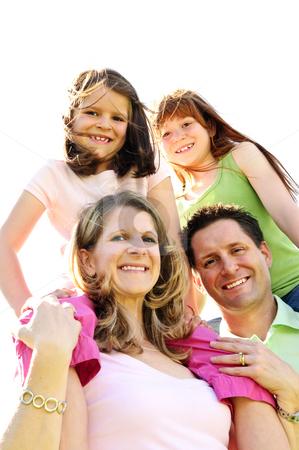 Happy family stock photo, Portrait of happy family giving children shoulder rides by Elena Elisseeva