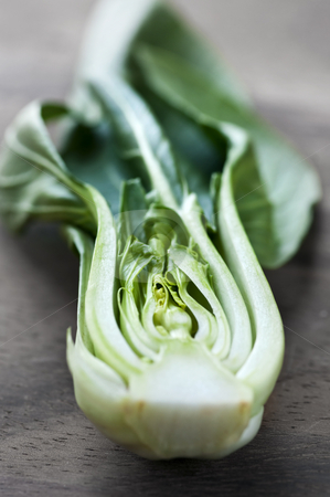 Bok choy stock photo, Close up of halved green bok choy vegetable greens by Elena Elisseeva
