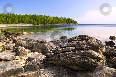 Rocks at shore of Georgian Bay stock photo, Rocks in clear water of Georgian Bay at Bruce peninsula Ontario Canada by Elena Elisseeva