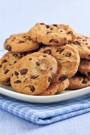 Chocolate chip cookies stock photo, Plate with big pile of chocolate chip cookies by Elena Elisseeva