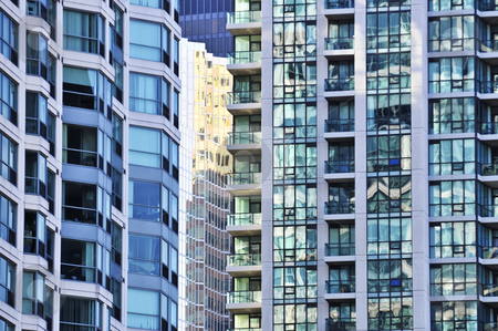 Apartment buildings stock photo, Tall condominium or apartment buildings in the city by Elena Elisseeva