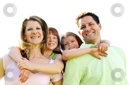 Happy family stock photo, Portrait of happy family giving children piggy back rides by Elena Elisseeva