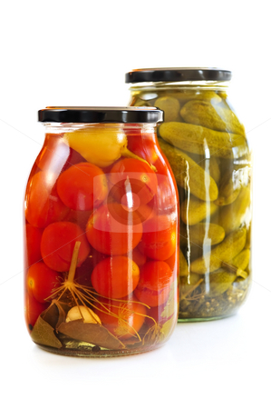 Jars of pickles stock photo, Two clear glass jars of colorful pickled vegetables by Elena Elisseeva