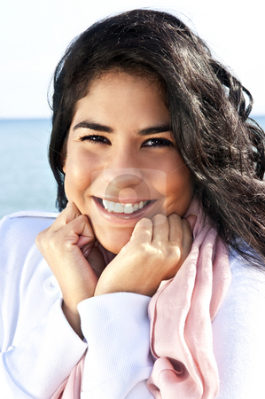 Young native american woman stock photo, Portrait of beautiful smiling native american girl with hands at her face by Elena Elisseeva