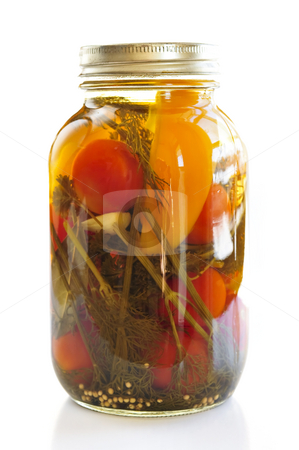 Jar of pickled vegetables stock photo, Clear glass jar of colorful pickled vegetables by Elena Elisseeva