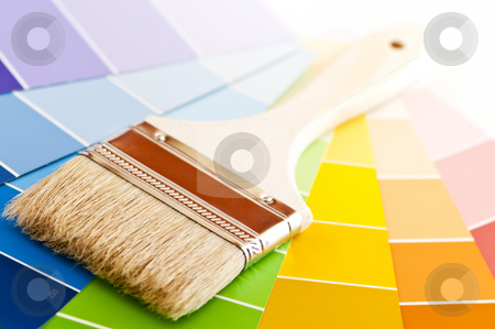 Paint brush with color cards stock photo, Clean paintbrush on rainbow of color card samples by Elena Elisseeva