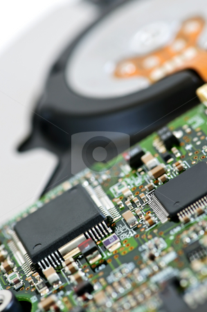 Hard drive detail stock photo, Closeup of hard disk drive internal electronics by Elena Elisseeva