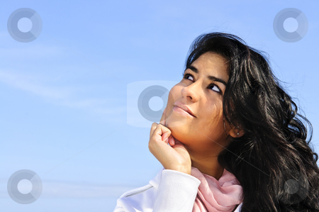 Beautiful young woman looking up stock photo, Portrait of beautiful smiling girl looking up by Elena Elisseeva