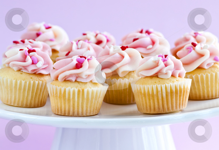Cupcakes stock photo, Lots of tasty cupcakes with icing on serving tray by Elena Elisseeva