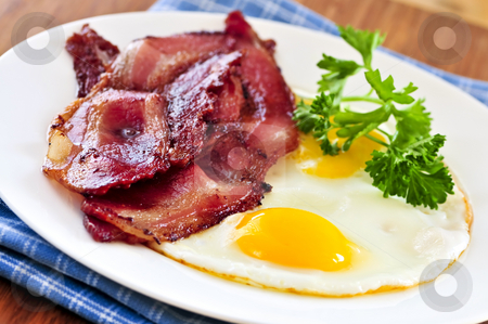 Bacon and eggs stock photo, Tasty breakfast of bacon and fried eggs by Elena Elisseeva