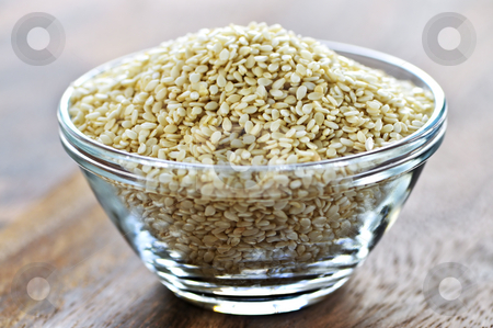 Sesame seeds stock photo, Sesame seeds close up in glass bowl by Elena Elisseeva