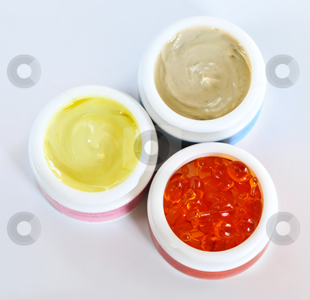 Skin care creams stock photo, Colorful jars of skin care creams and lotions by Elena Elisseeva
