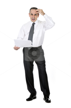 Confused businessman stock photo, Business man in suit with confused expression holding papers by Elena Elisseeva