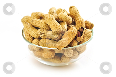 Peanuts stock photo, Closeup on bowl of peanuts with shells by Elena Elisseeva