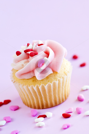 Cupcake stock photo, Single cupcake with pink icing and sprinkles by Elena Elisseeva