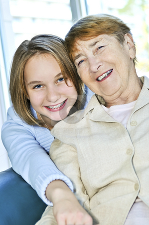 Granddaughter visiting grandmother stock photo, Granddaughter giving a hug to her grandmother by Elena Elisseeva