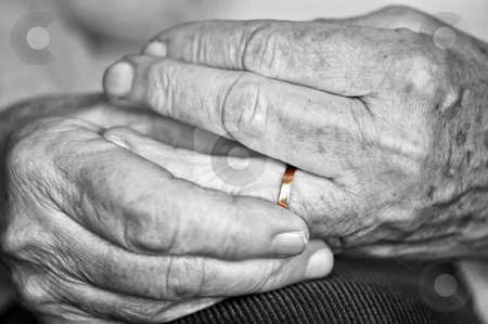 Old hands with wedding band stock photo, Close up on elderly woman hands with golden wedding ring by Elena Elisseeva