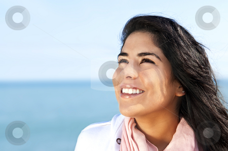 Young native american woman stock photo, Portrait of beautiful smiling hopeful native american girl by Elena Elisseeva