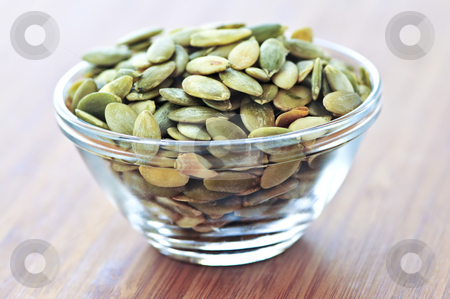 Pumpkin seeds stock photo, Pumpkin seeds close up in glass bowl by Elena Elisseeva