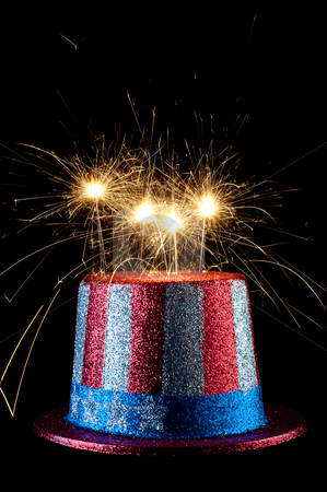 A festive 4th of July hat with sparklers stock photo, A festive 4th of July hat with sparklers by Vince Clements