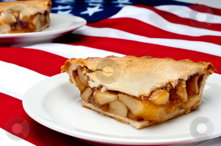 Shallow focus horizontal image of 2 pcs of apple pie on the Amer stock photo, Shallow focus horizontal image of 2 pcs of apple pie on the American flag by Vince Clements