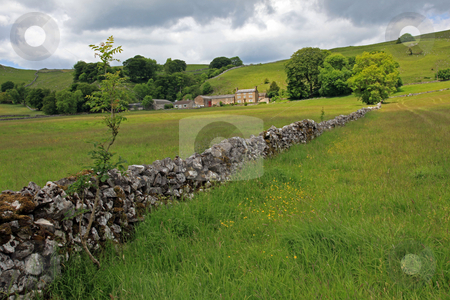 Dry stone wall in Derbyshire England stock photo, In the hills of England dry stone walls are made to divide fields as no hedges will grow in the shallow  soil. by Ian Langley