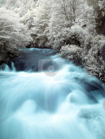 Mountain stream stock photo, Slow motion powerful mountain stream in infrared by Laurent Dambies