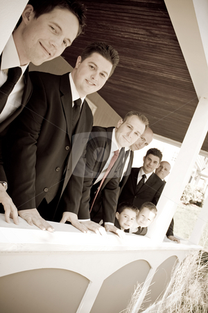 Wedding Party Groomsmen stock photo, A groom and his groomsmen posing together in a row. by Todd Arena