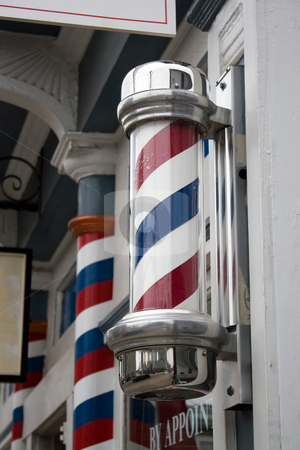 Barber Shop Pole stock photo, An old antique barber shop pole with red and blue stripes. by Todd Arena