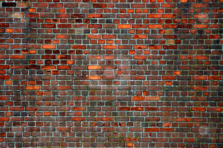 Brick Wall stock photo, A brick wall background that has been well weathered from many years of neglect. by Tom Weatherhead